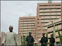 Man and police in front of government building