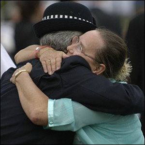 A mourner and a policewoman embrace in Regent's Park