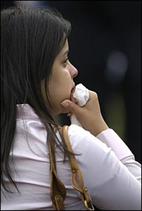 A woman cries as she watches the service