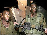 Israeli troops black up for night operations near Gaza border (file photo)