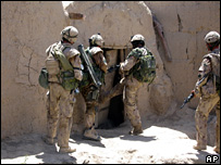 Coalition troops patrol in Kandahar