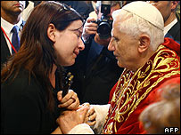 Pope comforts relative of underground crash victim