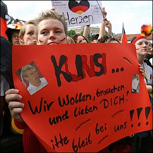 A Germany fan holds up a banner showing her support for Jurgen Klinsmann