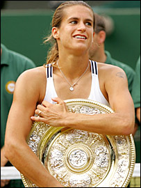 Amelie Mauresmo gets possessive with the trophy