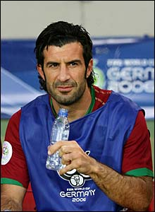 Luis Figo sits on the bench