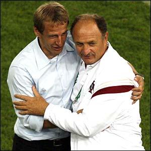Jurgen Klinsmann and Luiz Felipe Scolari hug