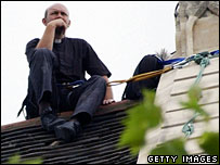 Father Malcolm Hunter on a church roof