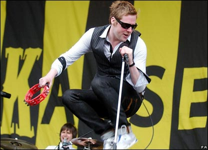 Kaiser Chiefs lead singer Ricky Wilson jumps for joy on the main stage