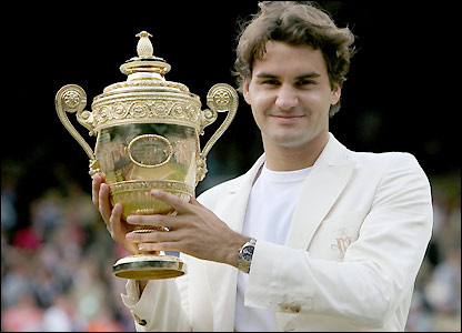 Roger Federer holds the trophy and confirms himself as one of the greats of the game