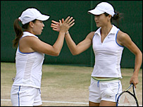 The Chinese pair celebrate a crucial point in the third set