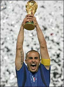 Italy captain Fabio Cannavaro lifts the World Cup trophy