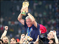 Italy coach Marcello Lippi holds aloft the World Cup trophy