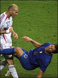 Marco Materazzi falls to the ground after being butted by Zinedine Zidane