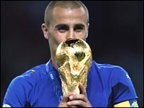Italian captain Fabio Cannavaro kisses the World Cup trophy