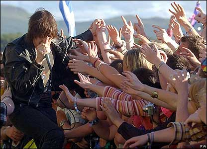 Fans grab the Strokes lead singer Julian Casablanca