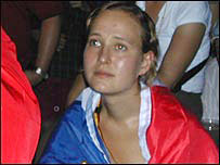 A French fan mourns her team's World Cup defeat