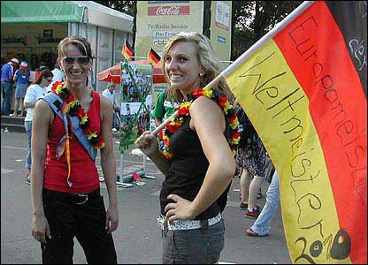 German football fans carry a Weltmeister flag