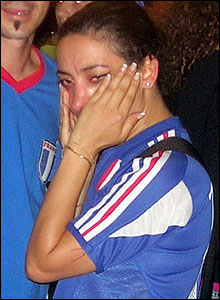 A female French fan wipes away her tears