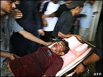 Injured Palestinian being taken to hospital