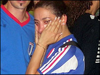 A French fan wipes away her tears (Flickr user Hugo*)