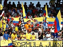 Fans at the US Grand Prix wave Colombian flags in support of Juan Pablo Montoya