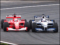 Juan Pablo Montoya (right) passes Michael Schumacher for the lead of the 2001 Brazilian Grand Prix