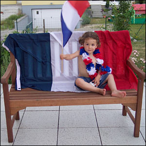 Alex sends this picture in of his two-and-a-half-year old daughter Manon on a flag decorated bench