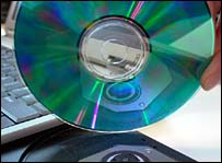 CD being put into a laptop