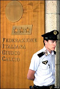 Security guard stands outside the HQ of Italy's football federation in Rome