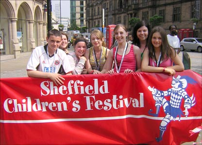 SHEFFIELD - Teenagers stand behind a banner advertising the Sheffield Childrens' Festival.