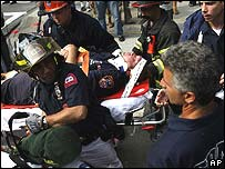 Injured firefighter is carried on a stretcher