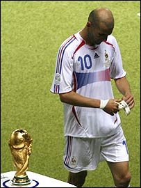 Zinedine Zidane trudges off past the trophy after being sent off in the World Cup final