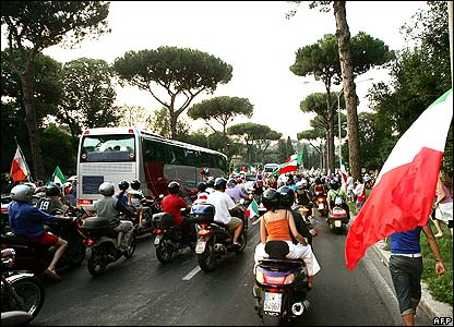 Fans follow Italy World Cup team bus