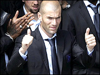 Zinedine Zidane acknowledges the crowd from the Crillon Hotel in Paris