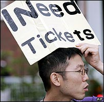 Fan with sign pleading for tickets