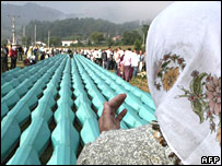 Bosnian Muslim woman in front of the remains of Srebrenica victims