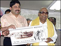 Tamil Nadu Chief Minister M Karunanidhi (right) with the stamp