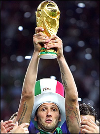 Marco Materazzi holds the World Cup trophy aloft