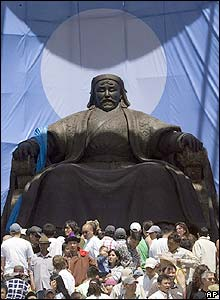 Crowds in front of a vast statue of Genghis Khan in Ulan Bator