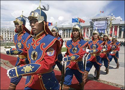 Mongolian state guards in official dress march across Sukhbataar Square in the capital, Ulan Bator
