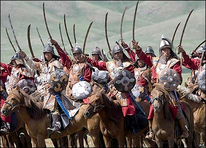 Soldiers re-enact a Mongolian battle charge