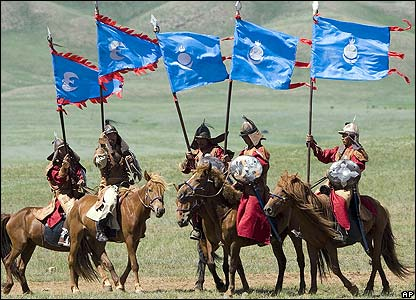 Mongolian soldiers in traditional outfits prepare to re-enact the triumphs of Genghis Khan
