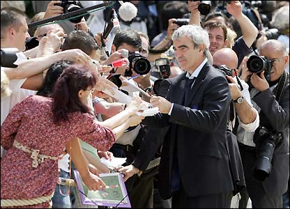 Raymond Domenech signs autographs