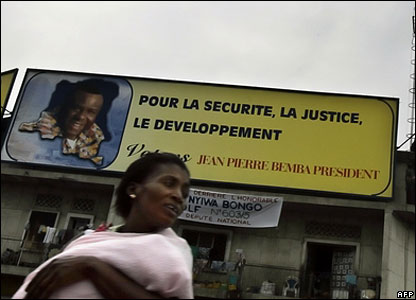 Woman in front of Jean-Pierre Bemba poster
