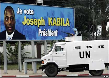UN truck in front of Kabila poster