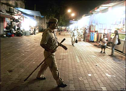 Policeman patrols in Delhi on 11 July