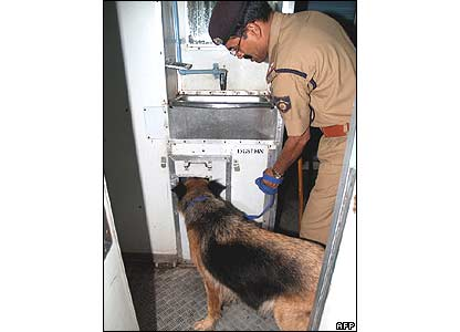 Security officer checks a Mumbai-bound train in Ahmedabad for bombs