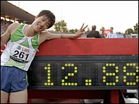 Liu Xiang celebrates his new world record