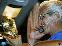 Italy football coach Marcello Lippi on mobile after World Cup win