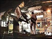 Policeman entering wrecked carriage